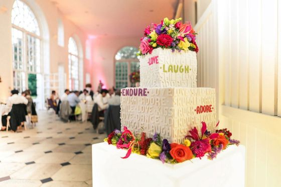 August saw a departure from the decadent ruffles and dragged us into the 21st century. You can see Andri's touch in this Summer wedding at Kew Gardens, with pops of vibrant colour, clean lines and attention to detail. Agonising hours of letter cutting in the middle of a heatwave was worth it, to see a cake so befitting the couple and theme!