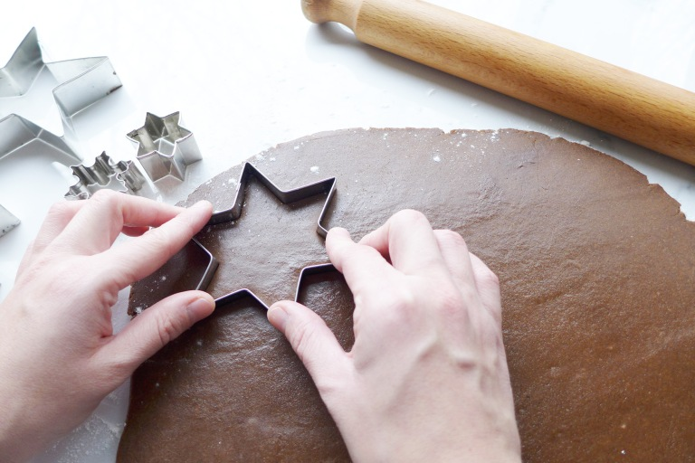 Cutting out gingerbread shapes