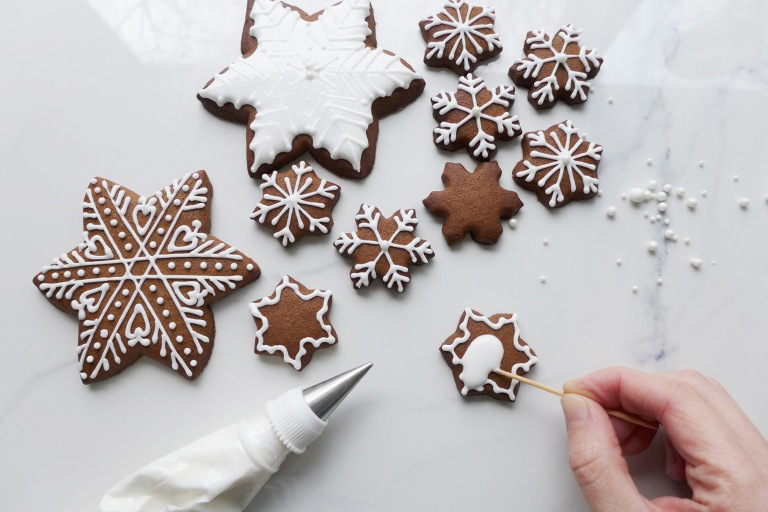 Decorating gingerbread snowflakes